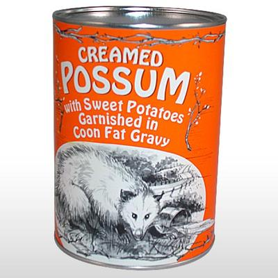 Mmmmm....coon gravy.  I like how this possum is crawling into a can.  Or is that a drainage ditch?  All I know is that this animal looks so shamed and miserable that you are almost glad it got crammed into a can with assorted tuber mush...